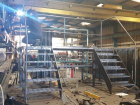 steel platform being welded by an engineer