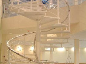 Spiral staircase in a building created by White Cross Ring