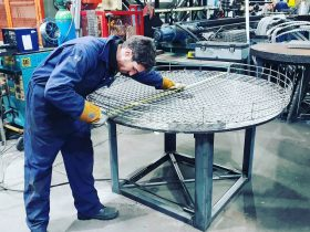 Engineer measuring metal work