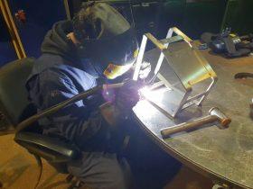 White Cross Ring engineer welding