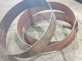 Rolled mild steel band in the White Cross Ring workshop