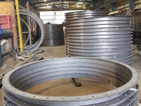 Large metal rings in the White Cross Ring workshop