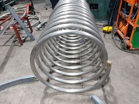 Section bent tube spiralled by White Cross Ring