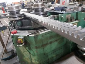 Section bending machine and metal component