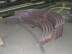 Channel section bent by White Cross Ring